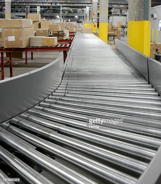 Conveyor rollers in a warehouse