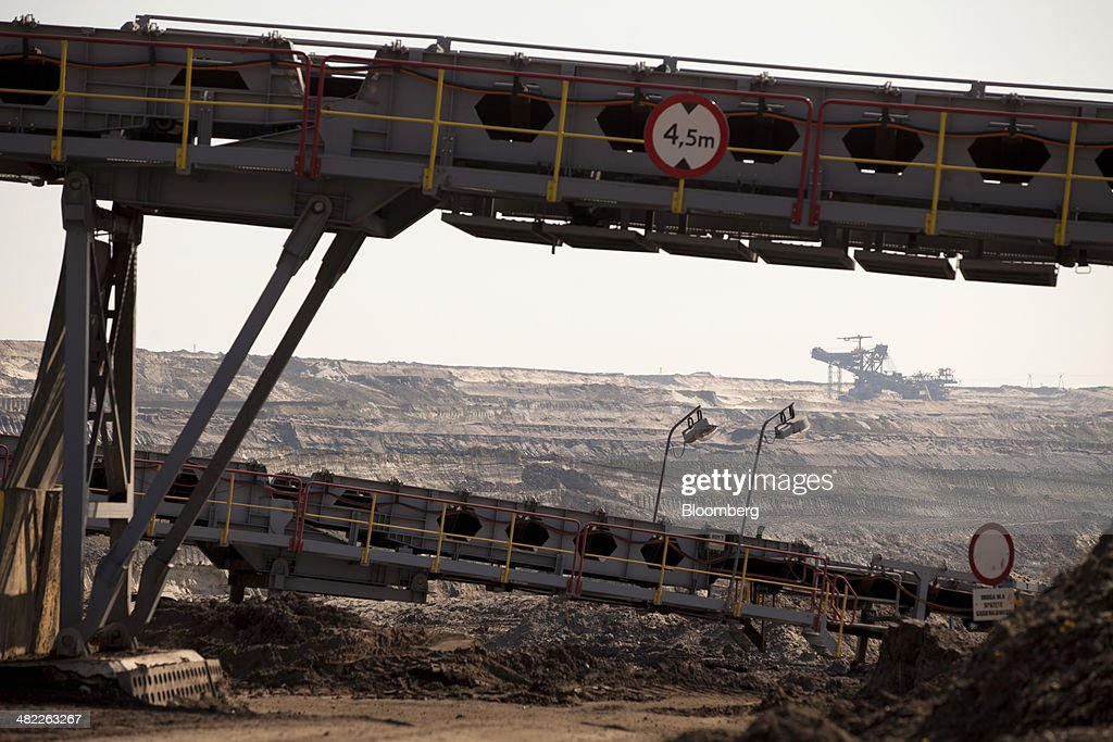 Conveyor systems transport lignite, also known as brown coal, from the pit floor to the power plant during digging operations at the open pit mine operated by PGE Elektrownia Belchatow SA near Belchatow, Poland, on Wednesday, April 2, 2014. Polish power prices are set to stay above German contracts through 2015, reversing a historic discount, as the cost of keeping plants open in the eastern European nation is factored in, according to Vattenfall AB. Photographer: Bartek Sadowski/Bloomberg via Getty Images