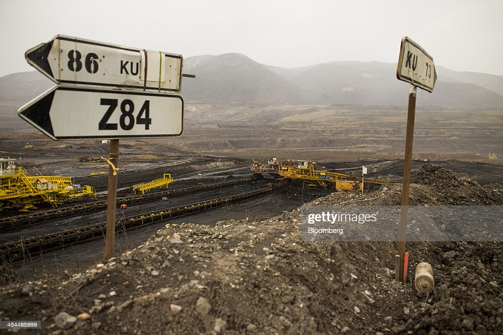 Conveyors used to transport lignite, also known as brown coal, operate near road signs in the open pit mine operated by Czech Coal AS near the town of Horni Jiretin, Czech Republic, on Friday, Dec. 6, 2013. The government may set up a joint company with Severni Energeticka that will seek lifting current environmental limits on lignite mining, Lidove Noviny reports, citing proposal submitted by Industry and Trade Ministry. Photographer: Bartek Sadowski/Bloomberg via Getty Images