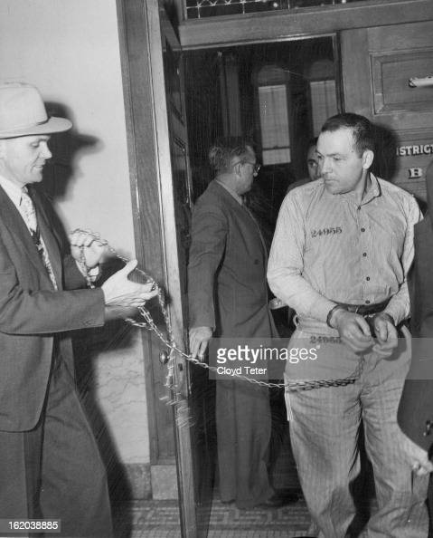 APR 14 1952 APR 15 1952 Convict Led Away After Hearing Guard William Kinney leads shackled convict Arthur Fisk out of the grand jury hearing room in...