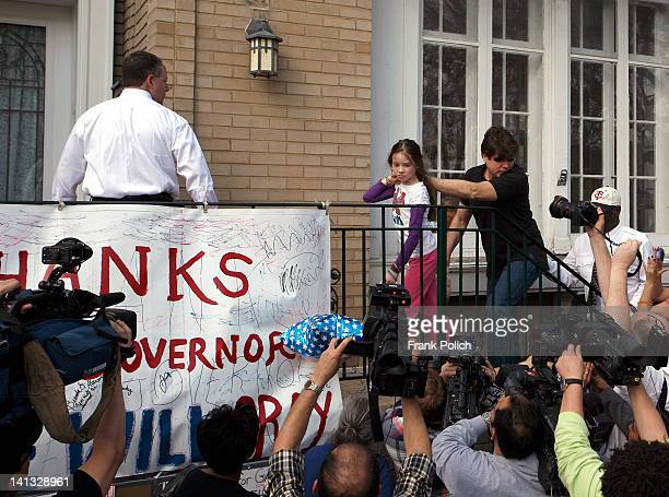 Convicted former Illinois Governor Rod Blagojevich holds hands with his daughter Annie as they walk past the media toward his home March 14 2012 in...