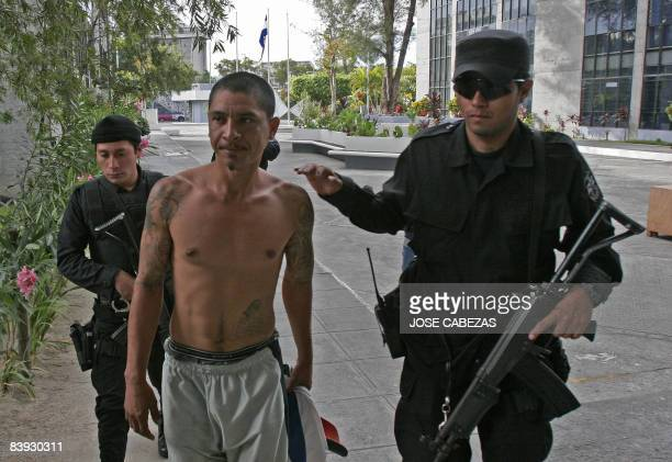 A convicted member of the Mara Salvatrucha gang is brought under custody outside the Isidro Menendez Justice Court after he was recaptured by the...