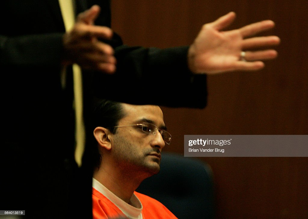 Convicted murderer and arsonist Pravin Govin right sits in Superior Court in Los Angeles Thursday morning as his attorney John Sweeney pleads with...