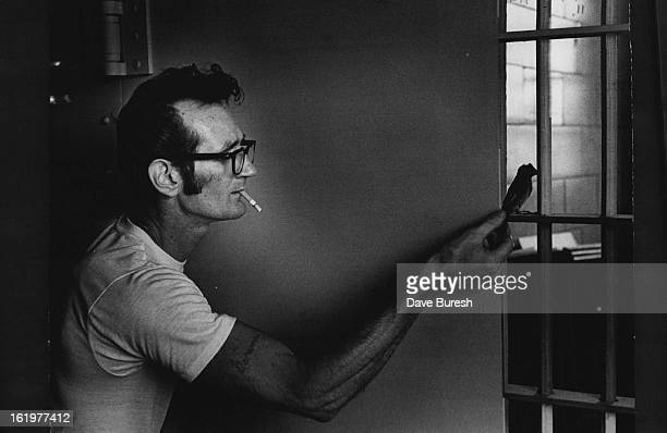 JUN 28 1972 JUN 30 1972 Convicted Murderer James D Manier Catches Pet Sparrow Deadeye which has been adopted by Manier and John Major Young