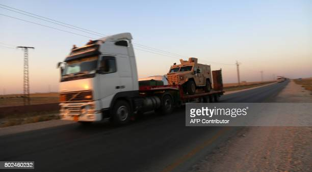 TOPSHOT A convoy carrying armoured vehicles and ammunition said to be supplied by the USled coalition is seen driving on a road controlled by the...