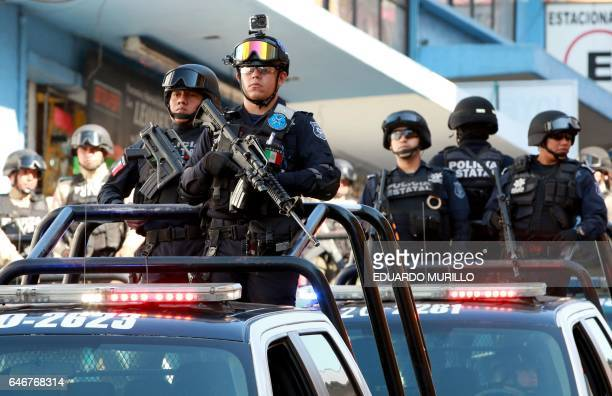 A convoy carrying gendarmerie civil and state police personnel arrives in Jalapa Veracruz state Mexico to strengthen security on March 1 2017 / AFP...