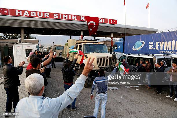 A convoy carrying heavy weapons belonging to Iraqi Kurdish Peshmerga forces crosses into Turkey from the Habur border crossing on TurkishIraqi border...