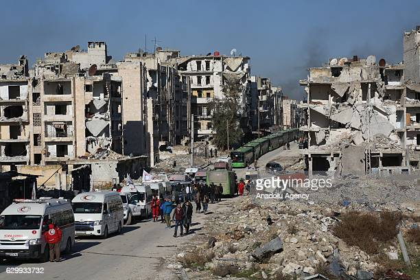 A convoy including busses and ambulances wait at a crossing point at Amiriyah District of Aleppo Syria on December 15 2016 to evacuate civilians...