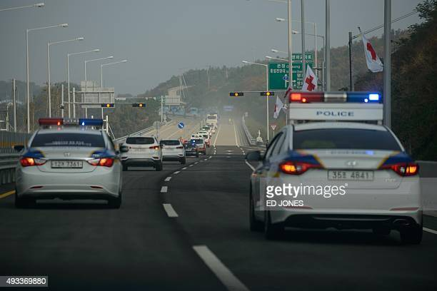 A convoy of busses carrying South Koreans chosen to attend a family reunion event with their North Korean relatives makes its way towards the...