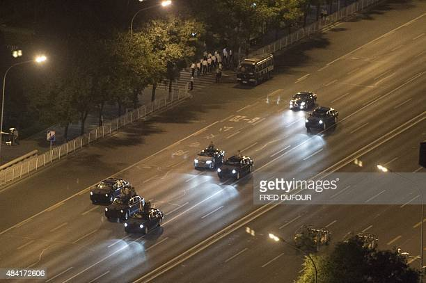 A convoy of Chinese military vehicles drive on a closedoff road during a rehearsal for a military parade to mark the 70th anniversary of the end of...