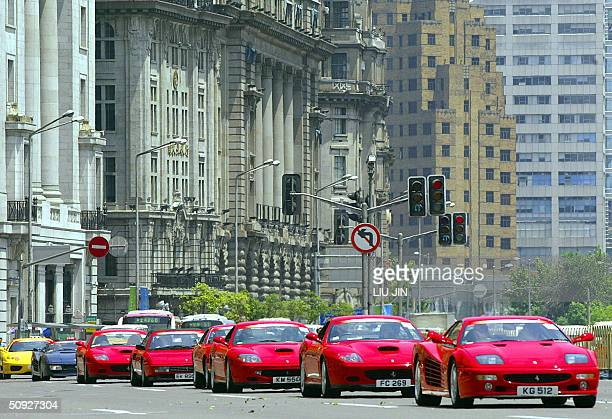 A convoy of Ferrari sports cars parade along the Bund as the start of the FerrariMaserati's showroom opening ceremony in Shanghai 05 June 2004 Around...