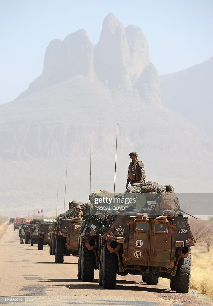 A convoy of French army vehicules head toward Gao on February 7, 2013 on the road from Gossi. Four Malian civilians were killed by a landmine in territory reclaimed from Islamist rebels, police said as France mulled handing over its four-week-old intervention to UN peacekeepers.