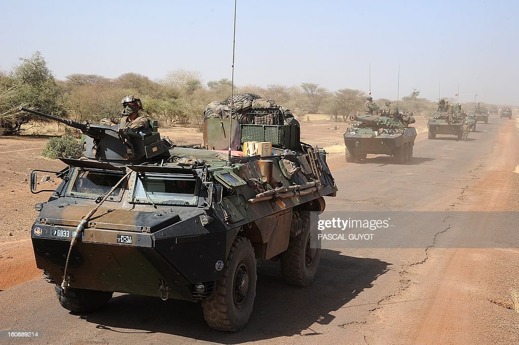 A convoy of French army vehicules heads toward Gao on February 7, 2013 on the road from Gossi. Four Malian civilians were killed by a landmine in territory reclaimed from Islamist rebels, police said as France mulled handing over its four-week-old intervention to UN peacekeepers. AFP PHOTO / PASCAL GUYOT