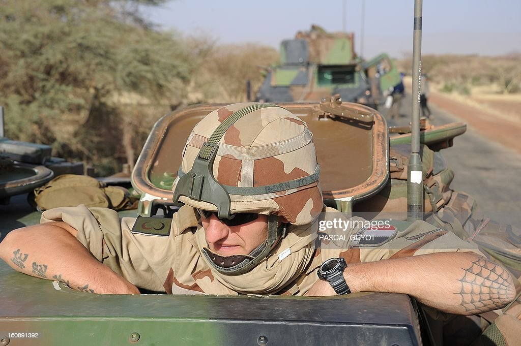 A convoy of French army vehicules heads toward Gao on February 7, 2013 on the road from Gossi. Four Malian civilians were killed by a landmine in territory reclaimed from Islamist rebels, police said as France mulled handing over its four-week-old intervention to UN peacekeepers.