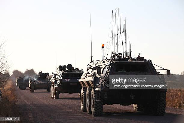 A convoy of German Army TPz Fuchs armored personnel carriers.