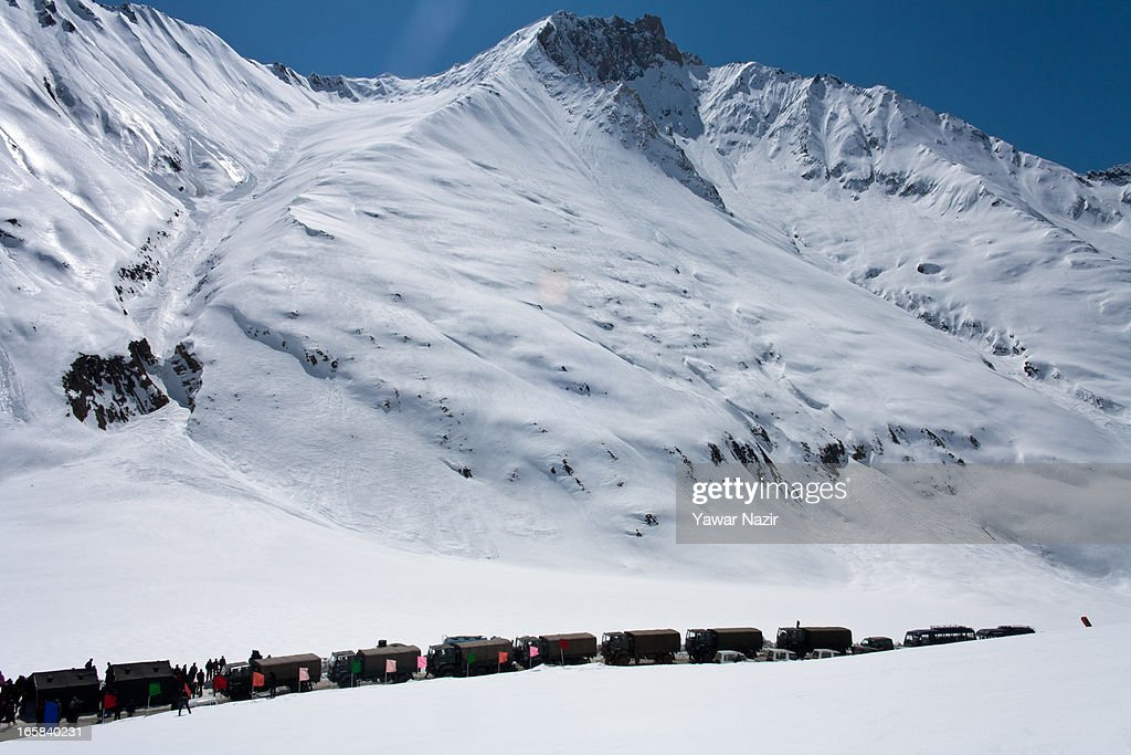 A convoy of Indian army waits for authorities to reopen the snow-cleared Srinagar-Leh highway on Srinagar-Leh highway after it was reopen by authorities on April 06, 2013 in Zojila, 108 km (67 miles) east of Srinagar, the summer capital of Indian administered Kashmir, India. The 443 km (275 miles) long Srinagar-Leh highway was opened for vehicular traffic by Indian Border Roads Organisation after remaining snowbound at Zojila Pass for the past six months. The pass connects Kashmir with Ladakh region a famous tourist destination among foreign tourists for its monasteries, landscapes and mountains.