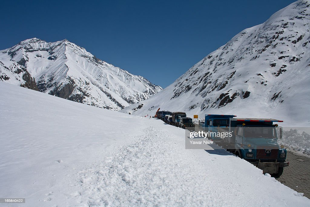 A convoy of Indian Border Roads Organisation waits for authorities to reopen the snow-cleared Srinagar-Leh highway on Srinagar-Leh highway after it was reopen by authorities on April 06, 2013 in Zojila, 108 km (67 miles) east of Srinagar, the summer capital of Indian administered Kashmir, India. The 443 km (275 miles) long Srinagar-Leh highway was opened for vehicular traffic by Indian Border Roads Organisation after remaining snowbound at Zojila Pass for the past six months. The pass connects Kashmir with Ladakh region a famous tourist destination among foreign tourists for its monasteries, landscapes and mountains.