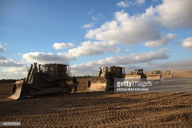 A convoy of Israeli armoured bulldozers move towards the IsraeliGaza border on July 18 2014 Israel warned it could broaden a Gaza ground assault...