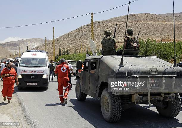 A convoy of Lebanese Red Cross vehicles evacuates the wounded from the northeastern town of Arsal in Lebanon's eastern Bekaa Valley on August 7 after...