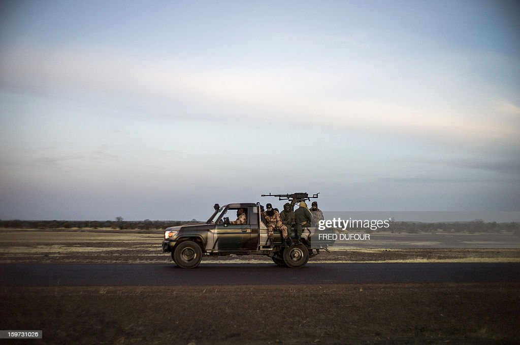 A convoy of Malian soldiers are pictured on their way for Mopti, on January 19, 2013 in Kongena. West African leaders Saturday sought urgent financial and logistical aid from the United Nations for a regional force in Mali to boost a French-led offensive against Islamists bearing down from the north. AFP PHOTO / FRED DUFOUR