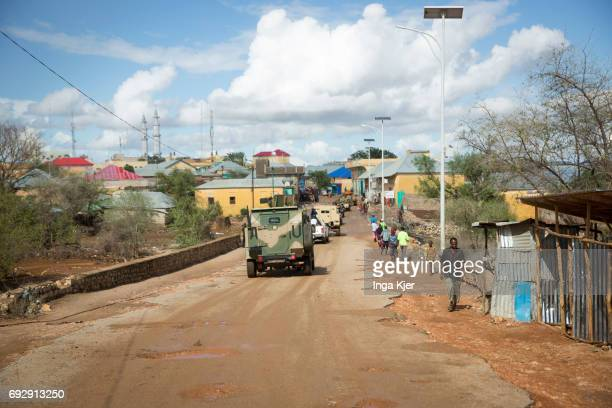 A convoy of military vehicles of the African Union is driving through a city in Somalia Street scene of Baidoa on May 01 2017 in Baidoa Somalia