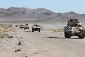 Convoy of military vehicles traveling in Fort Irwin, California.
