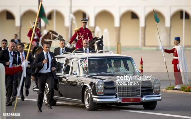 A convoy of Morocco's and Jordan's kings is seen arriving for a welcome ceremony at the Royal Palace in Rabat on March 22 2017 / AFP PHOTO / FADEL...
