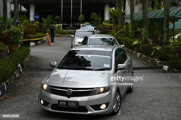 A convoy of Royal Malaysian Police vehicles carrying Vietnamese defendant Doan Thi Huong and Indonesian defendant Siti Aisyah leave the Shah Alam...