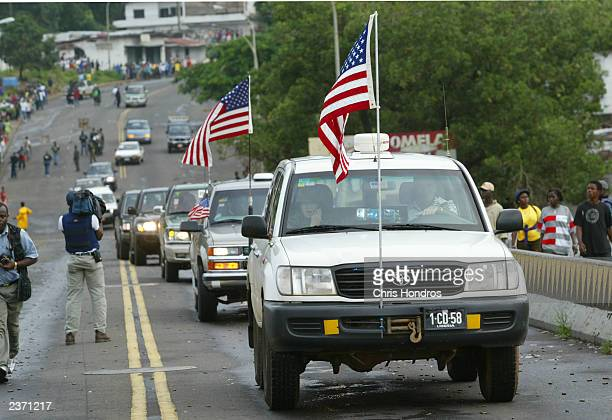 A convoy of the US ambassador and representatives pass over a key bridge into LURD rebel held territory August 5 2003 in Liberia US representatives...