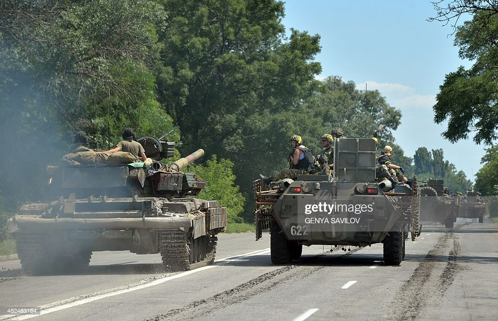 A convoy of Ukrainian tanks and Armoured Personnel Carriers passes through the eastern Ukrainian city of Druzhkivka north of Donetsk on July 21 2014...