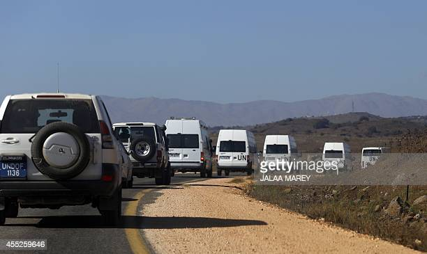 A convoy of UN vehicles carrying 45 Fijian peacekeepers members of the United Nations Disengagement Observer Force who were kidnapped two weeks ago...