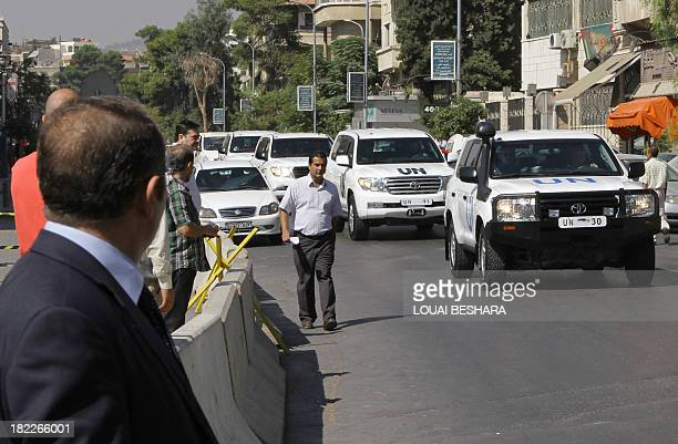 A convoy of United Nations vehicles carrying chemical weapons experts leaves a hotel in the Syrian capital Damascus on September 29 to investigate...