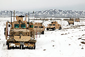 February 10, 2011 - U.S. Army soldiers travel down Route Dodge during a route clearing procedure, Paktika province, Afghanistan. The route clearing procedure was to deploy a mine clearing line charge