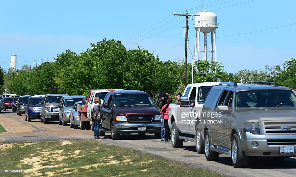 A convoy of vehicles waits in line to have their details taken down and vehicles marked by Texas Highway Patrol officers as residents are allowed to return to their destroyed homes near the site of the April 17 fertilizer plant blast in West, Texas, on April 20 2013. Investigators have been treating the blast site as a crime scene, although authorities say the blast was likely caused by a fire at the West Fertilizer Company, and access to the area has been restricted untl today with residents allowed to return. AFP PHOTO/Frederic J. BROWN