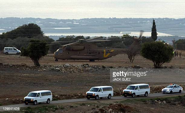 A convoy transporting Israeli soldier Gilad Shalit and his family is seen following their arrival by an Israeli air force helicopter near their home...