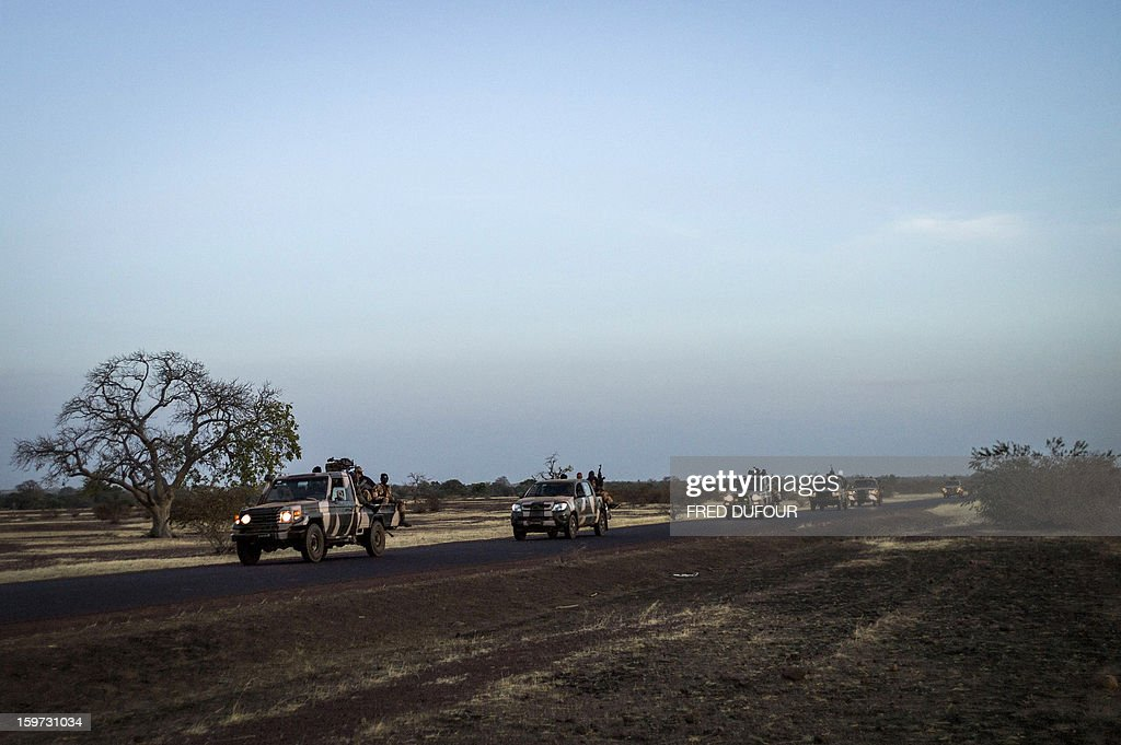 Convoys of Malian soldiers are pictured on their way for Mopti, on January 19, 2013 in Kongena. West African leaders Saturday sought urgent financial and logistical aid from the United Nations for a regional force in Mali to boost a French-led offensive against Islamists bearing down from the north. AFP PHOTO / FRED DUFOUR