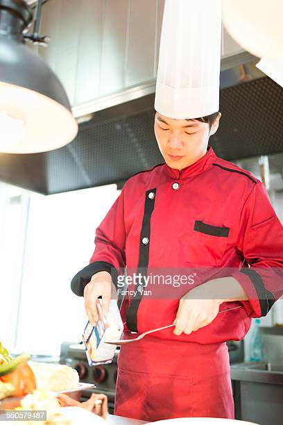 cook and chef working in restaurant