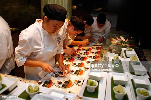 Cook Christina Enriquez left prepares Kachina Mosaic plates at Rivera Restaurant in Los Angeles