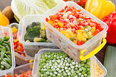 cook good frozen food recipes vegetables in plastic containers. Healthy freezer food and meals.