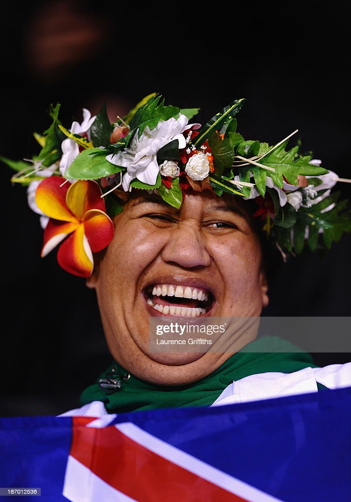 Cook Island fan looks on with a smile during the Rugby League World Cup GroupC/D match between Tonga and Cook Islands at Leigh Sports Village on...
