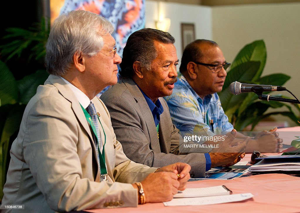 Cook Islands Prime Minister Henry Puna (C) talks to the media while Christopher Loeak President of the Marshall Islands (R) and Tuiloma Neroni Slade, Secretary General of the Pacific Islands Forum Secretariat listen, during a press conference at the Edgewater Resort in Rarotonga the largest Island in the Cook Islands on August 27, 2012. Australian Foreign Minister Bob Carr said regional powers need to get used to China's so-called chequebook diplomacy in the Pacific as it works to shore up support over Taiwan. Carr's comments came on the eve of the Pacific Islands Forum, a grouping of mainly small island states, along with resource-rich Papua New Guinea and the dominant regional powers Australia and New Zealand, both US allies. AFP PHOTO / Marty Melville