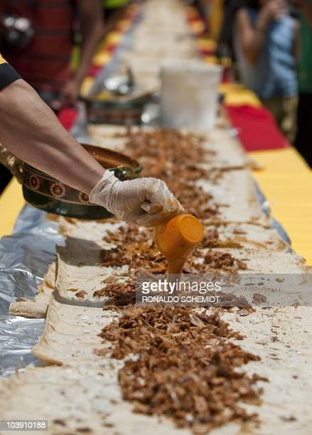 A cook makes a 409metrelong 'Taco' at Garibaldi square in Mexico City on September 3 2010 in the framework of the 1st Taco and Mariachi Festival in...