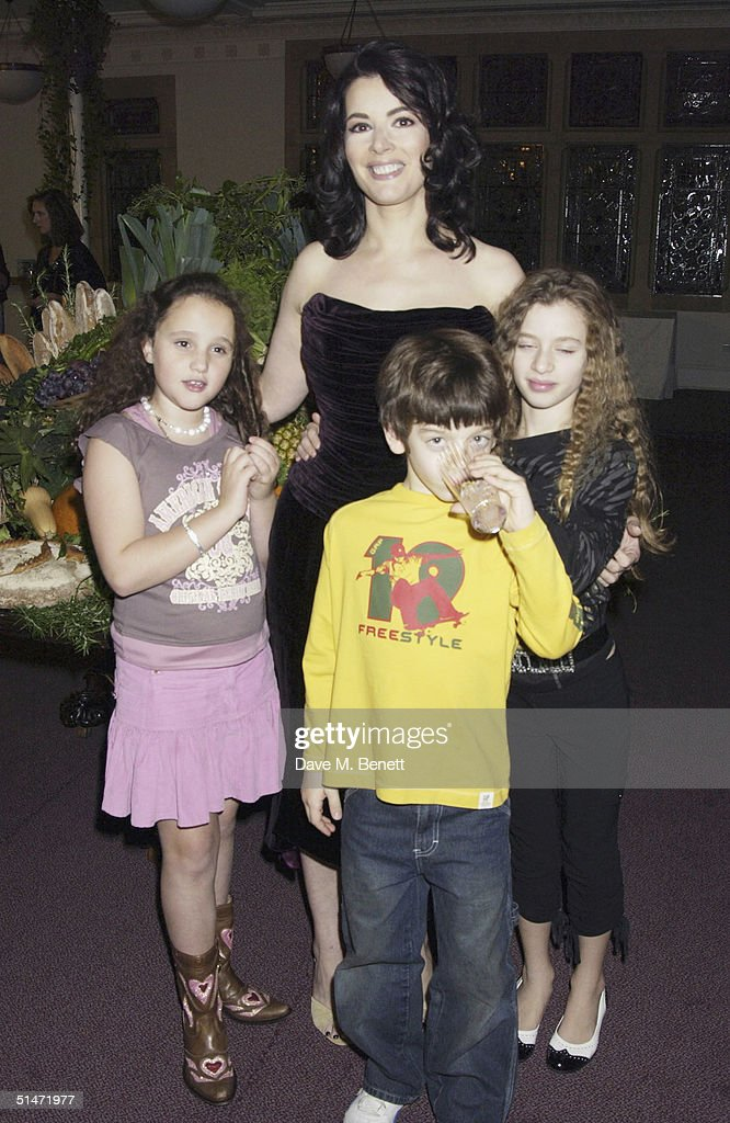 TV Cook Nigella Lawson with her step-daughter Phoebe and her children Bruno and Cosima attend the launch party celebrating the October release of 'Domestc Godess' Nigella Lawson's fifth cookery book 'Feast: Food That Celebrates Life' at the Culford Room, Cadogan Hall on October 11, 2004 in London.