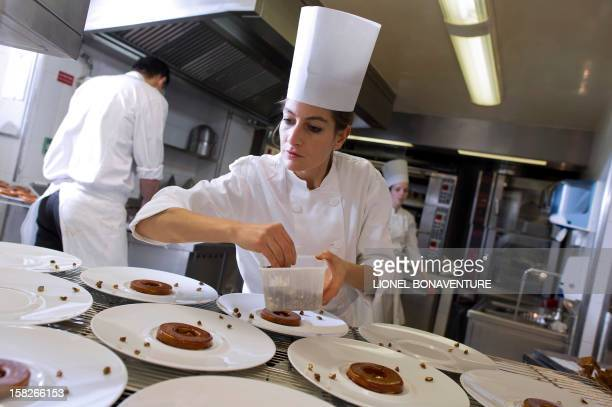A cook of the fivestar luxury hotel Le Bristol in Paris prepares dishes in the hotel's kitchen on December 6 2012 AFP PHOTO / LIONEL BONAVENTURE