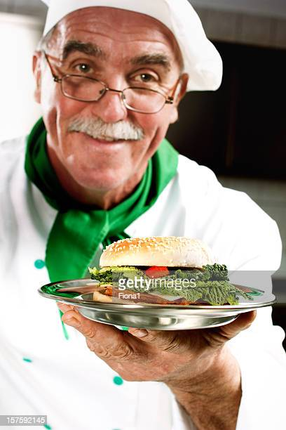 Cook offering hamburger