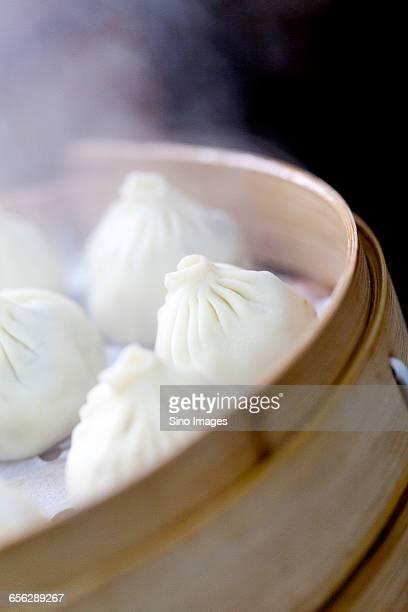 Cook Prepares Steamed Bun