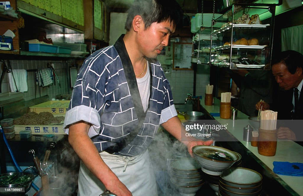 A cook prepares tachigui soba (soba is buckwheat) in a traditional stand-up soba shop in Dotombori, Osaka. : Stock Photo