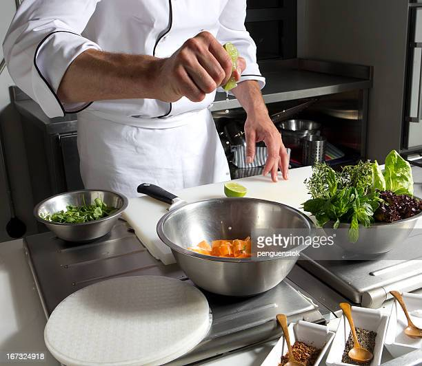 cook squeezing lemon on vegetable in cooking pot