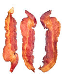 'Three cooked, crispy fried bacon isolated on a white background.  Good for many health and cooking inferences.'
