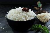 Basmati rice bowl, Cooked basmati rice in black bowl on dark moody background